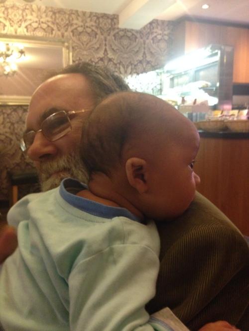 Reuben admires the ladies over Pop's shoulder.