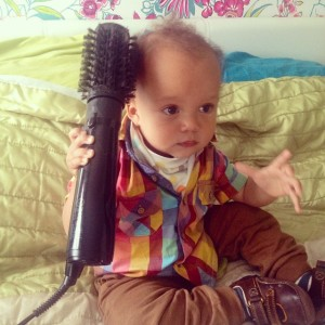 Reuben does his hair.