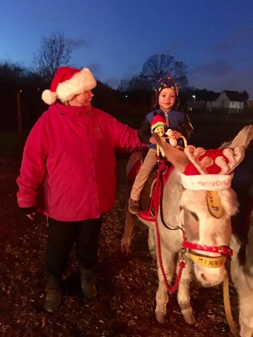 Donkey ride with Santa's Little Helper.