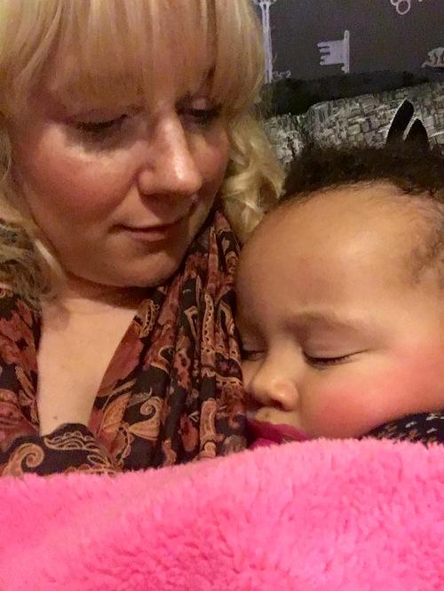 Roobs asleep on mummy.